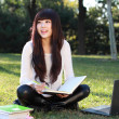 A smiling Asian student is studying. — Foto de stock #7153751