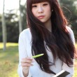 A smiling Asian student is studying. — Zdjęcie stockowe #7153807