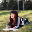 A smiling Asian student is studying. — Stock Photo #7153996