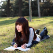 A smiling Asian student is studying. — Zdjęcie stockowe