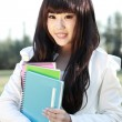 A smiling Asian student is studying. — Stock Photo
