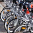 City Hire Bicycles Parked In Row - Foto de Stock