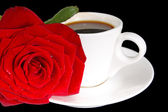 Coffee cup and red rose — Stok fotoğraf