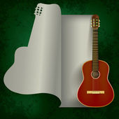 Acoustic guitar on green — Stock Vector