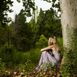Beautiful young lady in the forest — Stock Photo