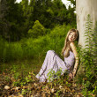 Beautiful young lady in the forest — Stock Photo #7147546