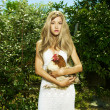 Beautiful woman with a pet - Chicken - Stock Photo