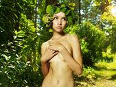 Beautiful lady in the grape wreath — Stock Photo
