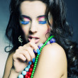 Royalty-Free Stock Photo: Young beautiful girl with bright beads