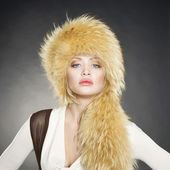 Young woman in fur hat — Stock Photo
