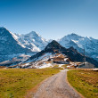 View from Maennlichen with Eiger Moench and Jungfrau - Stock Photo