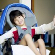 Stock Photo: Handsome four year old disabled boy in wheelchair opening front