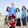 Stock Photo: Large family of seven standing on beach by ocean