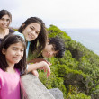 Four children along the ocean shore — Stock Photo