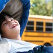 Disabled five year old boy in wheelchair outdoors by school bus — Stock Photo