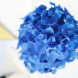 Stock Photo: Blue hydrangeflower next to pen and stationery, in calm yell