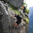 Stock Photo: Mountain climbing at Vorderer Gosausee near Dachstein