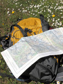 Hiking map and backpack — Stock Photo