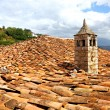 Chimey on red clay shingles roof - Stok fotoğraf