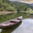 Boats on a quiet, calm, clear mountain river. - Stok fotoğraf