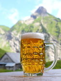 Beer in mountain scenery — Stock Photo