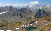 Calm green mountain lake — Stock Photo