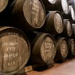 Port wine ages in barrels in cellar - Stok fotoğraf