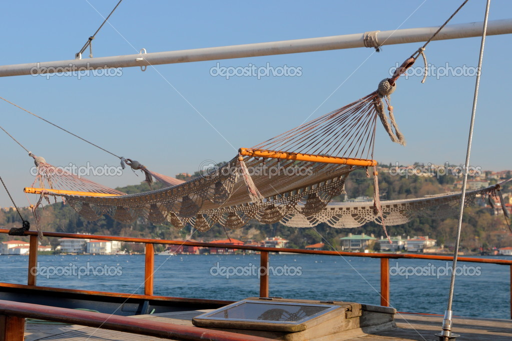 Two decorated hammocks on a yacht  invite to relax — Stock Photo #6953825