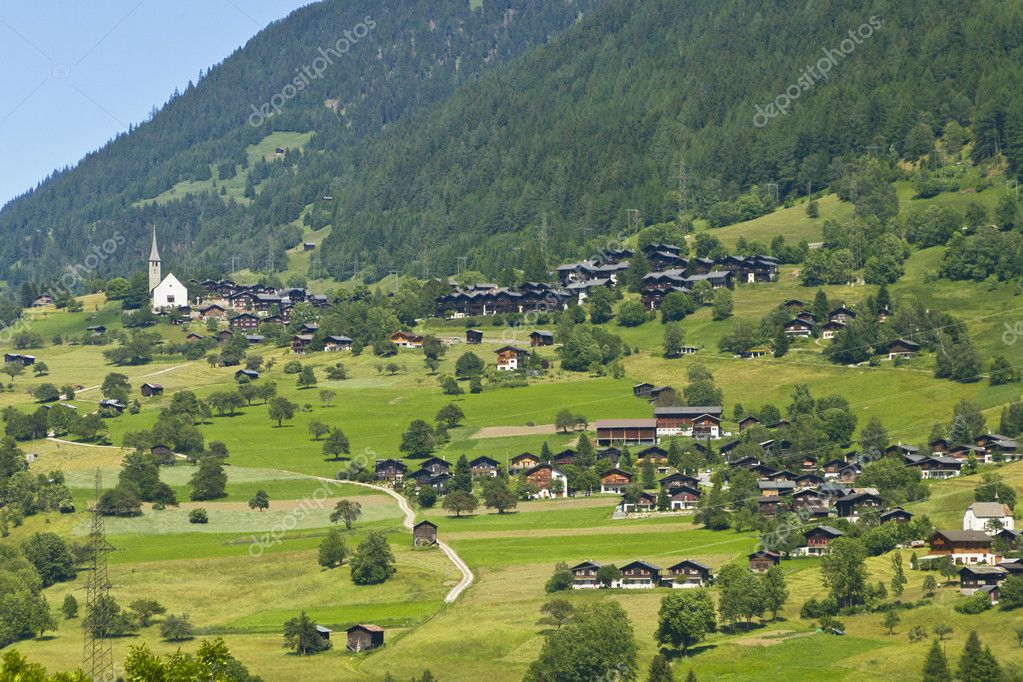 Picturesque walser village with little church and traditional wooden houses with wide roofs in the swiss alps — Stock Photo #6953895