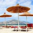 Straw parasols on the beach — Stock Photo