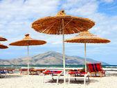 Straw parasols on the beach — Stock Photo