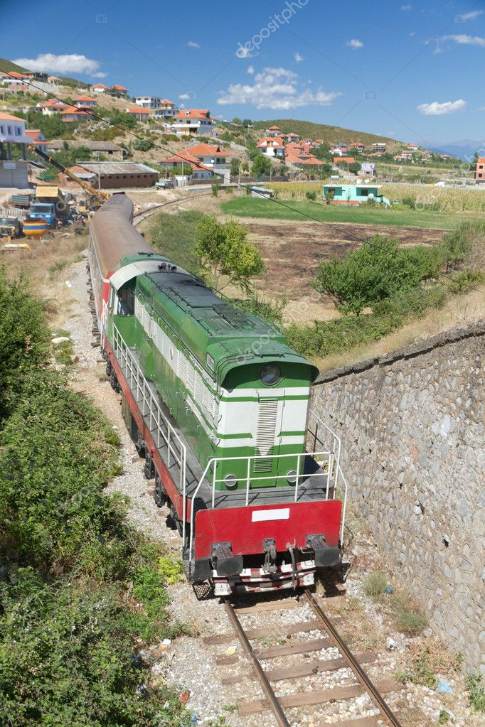 Historic train passing rural area in Albania seen from a bridge — Stock Photo #7020197