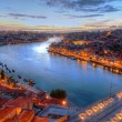 Stock Photo: Porto, river Duoro and bridge at night