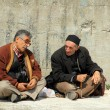 Turkish men chatting sitting at wall — Stock Photo #7103712