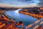Porto, il fiume douro e ponte di notte — Foto Stock