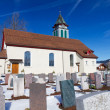 Graveyard with small church on a sunny winter day — Stock Photo #7149351