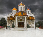 Orthodox church with copper roof and thunder storm — Stock Photo