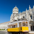 Yellow tram of Lisbon at Jeronimos monastery, Portugal — Stock Photo #7249369