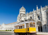 Yellow tram of Lisbon at Jeronimos monastery, Portugal — Stock Photo