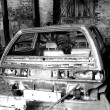 Car wreck in barn wreck, black and white - Stock Photo