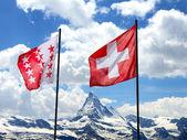 Swiss flags in front of Matterhorn — Stock Photo