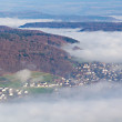Villages half under fog cover — Stock Photo
