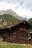 Withered wooden house in the mountains — Stock Photo