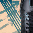 Close up black sport shoe on grunge background - Stock Photo