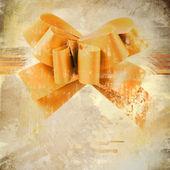 Gold holiday båge på grunge bakgrund — Stockfoto