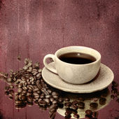 Coffee cup and roasted beans on vintage background — Stock Photo