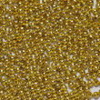 Gold jewelry beads from spilling on white background — Stock Photo