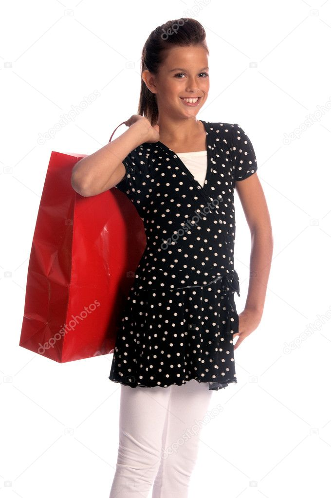 Twelve, 12 year old girl with a big red shopping bag, a huge smile and the shopping strut of a seasoned professional — Stock Photo #6896457