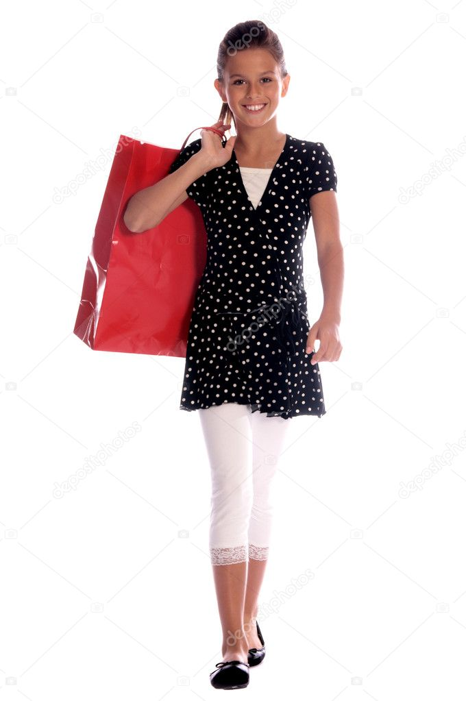 Twelve, 12 year old girl with a big red shopping bag and the shopping strut of a seasoned professional — Stock Photo #6896462