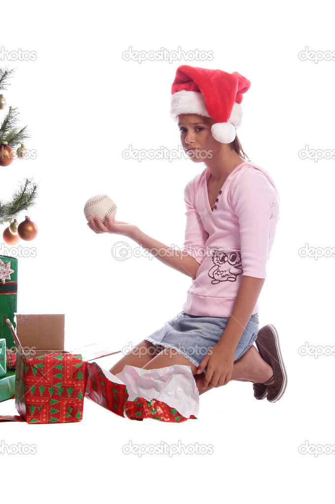 A young girl is dismayed that she got a softball for a christmas gift — Stock Photo #6896755